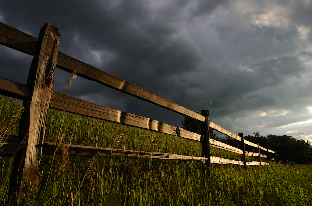 Dramatically lit fence in Storm
